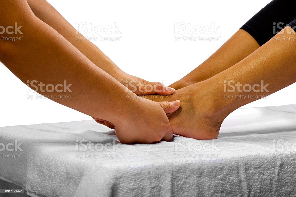 Young African American Woman Getting a Foot Massage royalty-free stock photo
