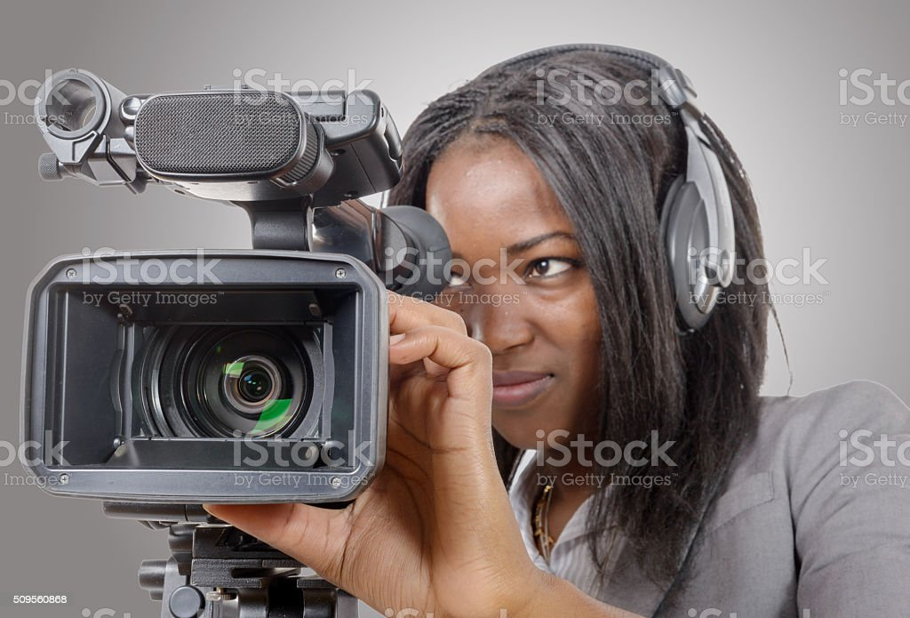 young African American women with professional video camera and stock photo