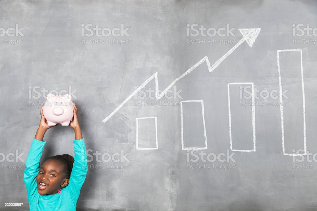Young african doing well with her piggy banks savings stock photo