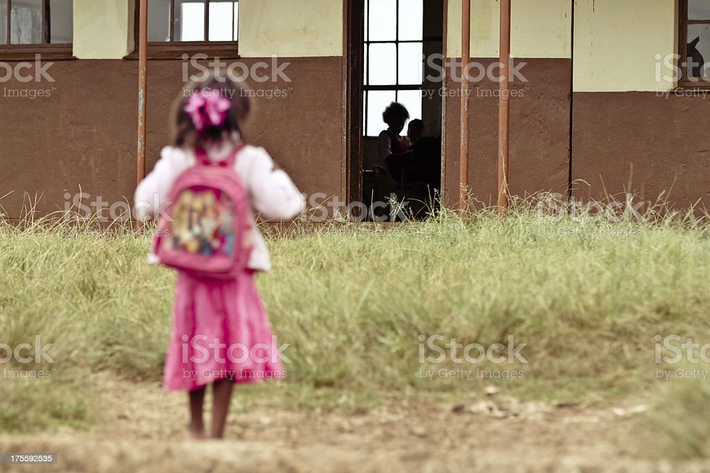 Young African girl nervous on her first day of school stock photo