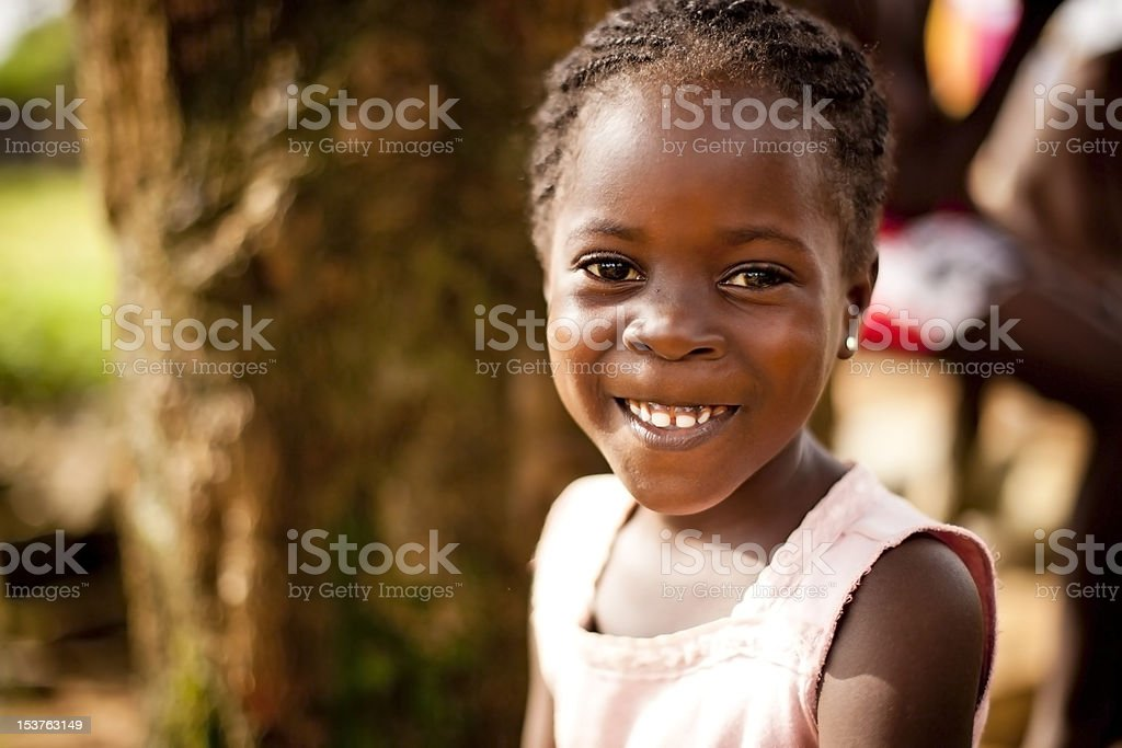 young african girl smiling happily stock photo
