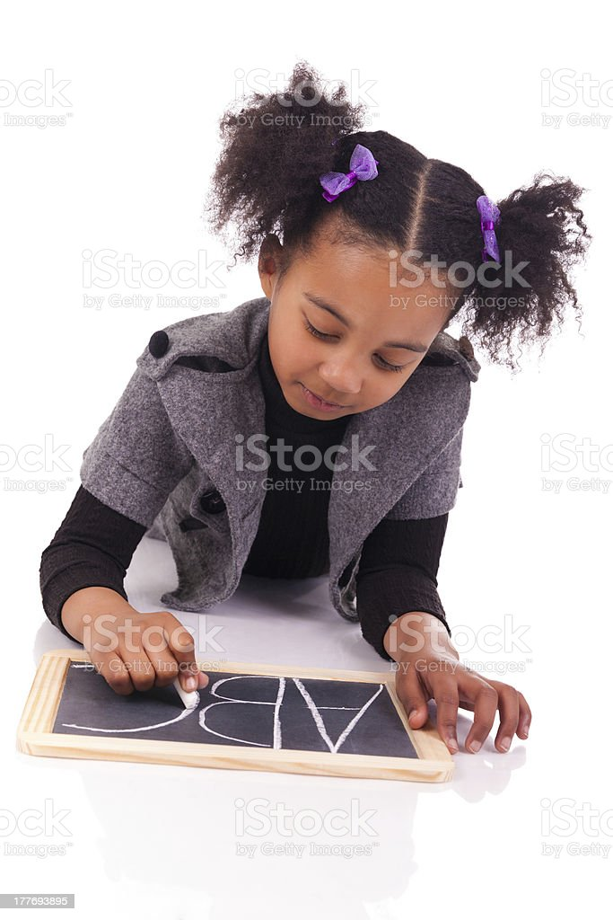 young African girl with a black slate royalty-free stock photo
