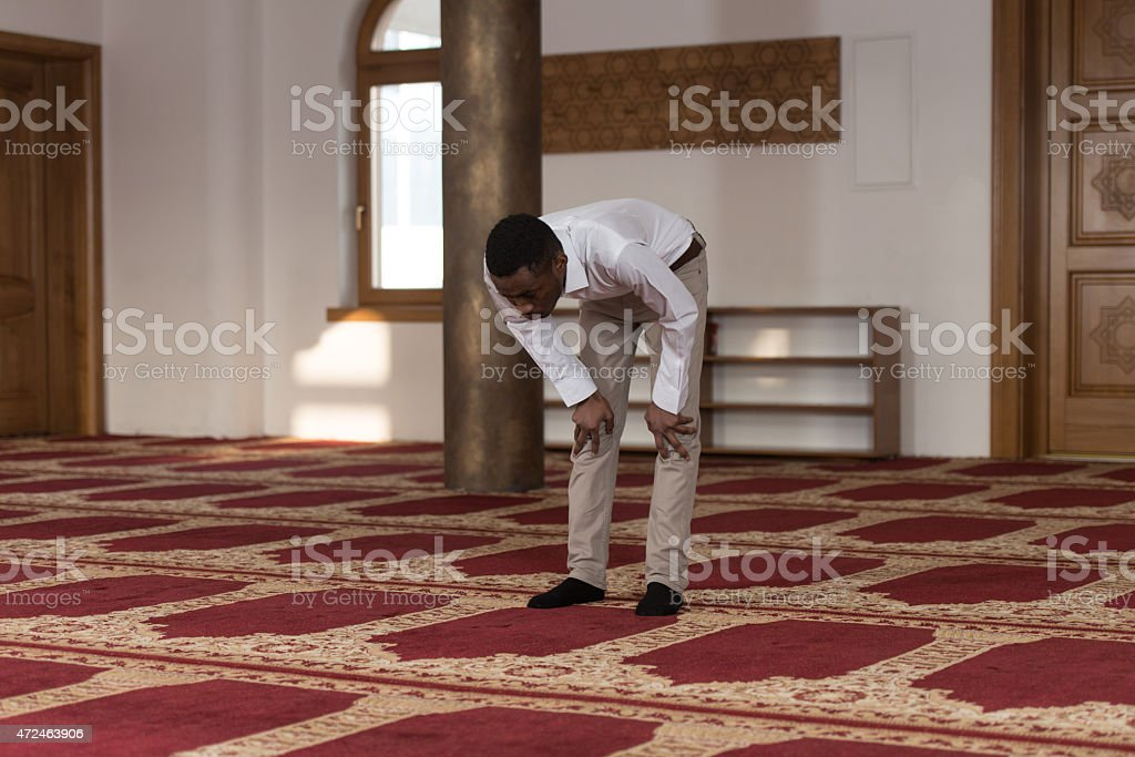 Young African Guy Praying stock photo