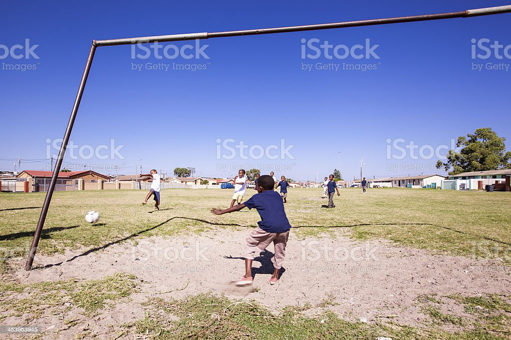 Young African Kids playing Football royalty-free stock photo