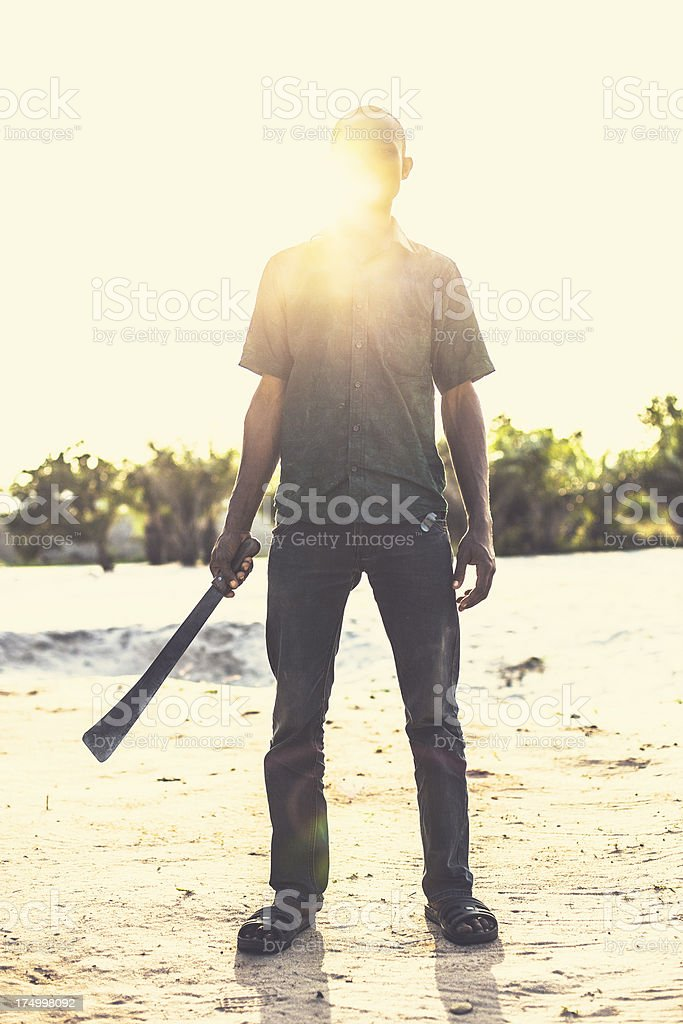 Young african man holding machete. royalty-free stock photo