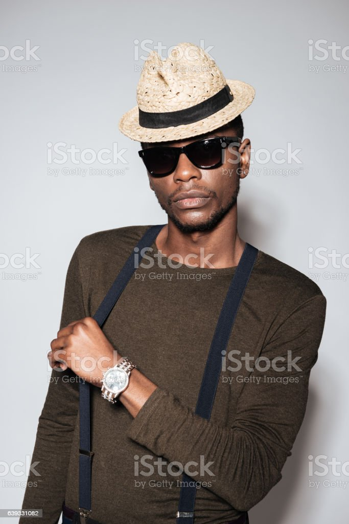 Young african man wearing hat and glasses stock photo