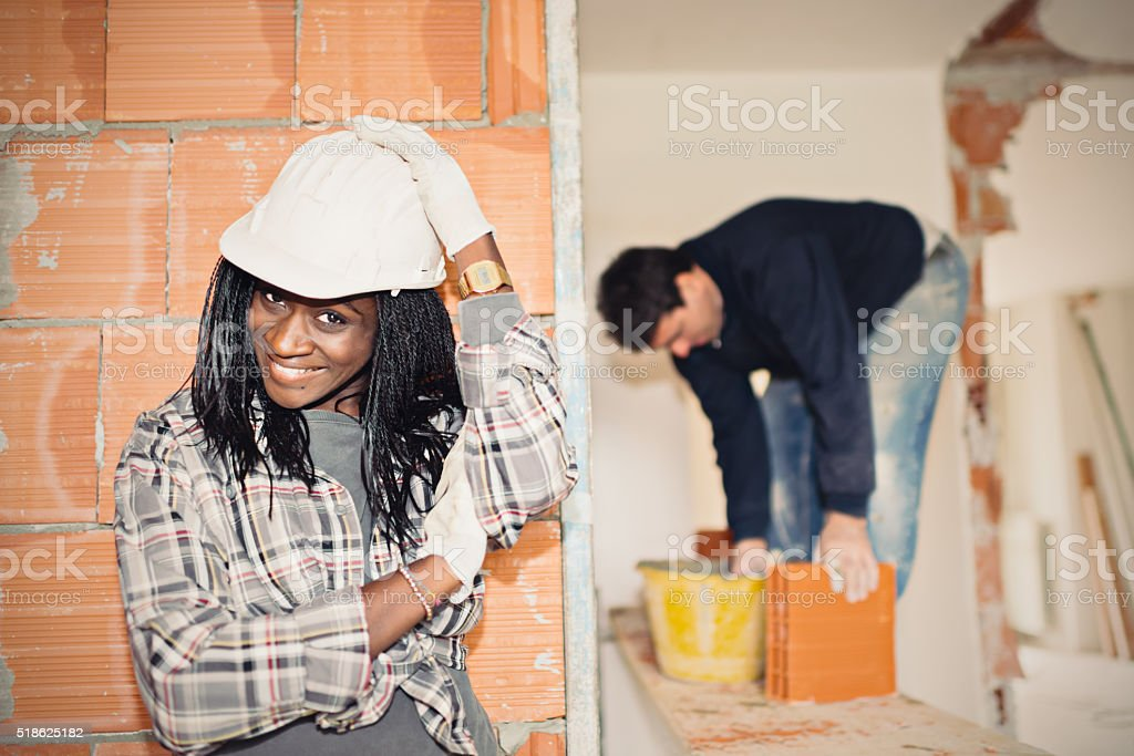 Young African trainee woman in building apartment stock photo