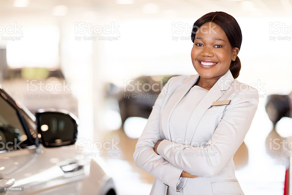 young african vehicle saleswoman stock photo