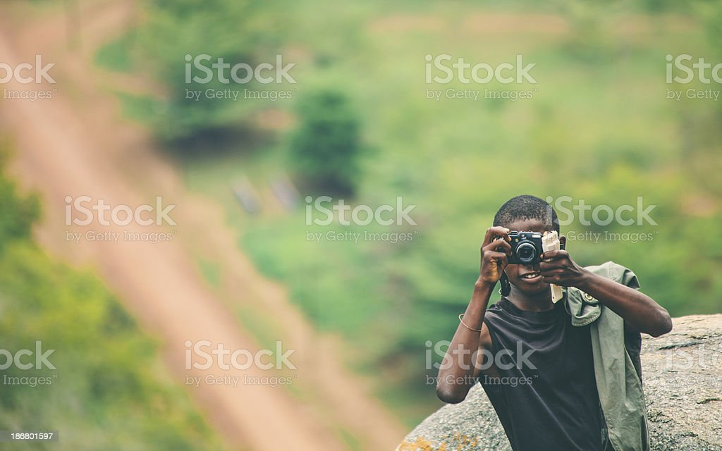 Young african with camera. royalty-free stock photo