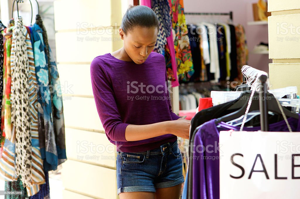 Young african woman at apparel store stock photo