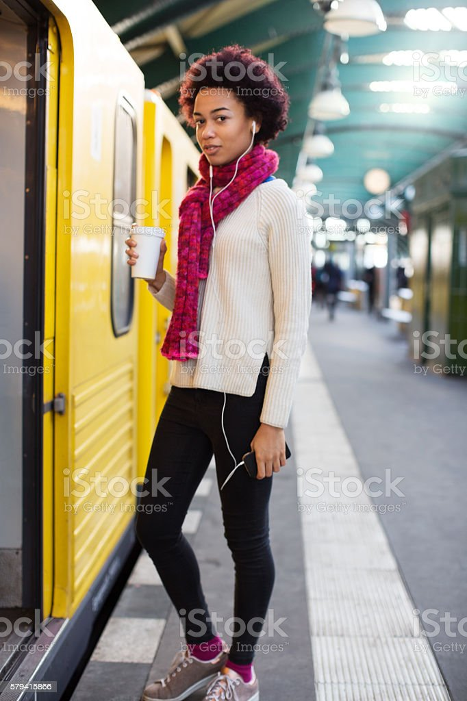 Young african woman boarding a train stock photo