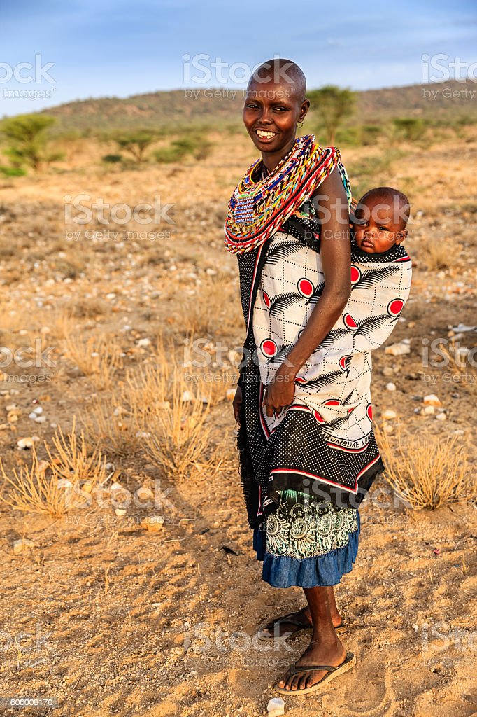 Young African woman carrying her baby, Kenya, East Africa stock photo