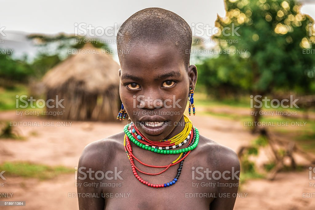 Young african woman in her village stock photo