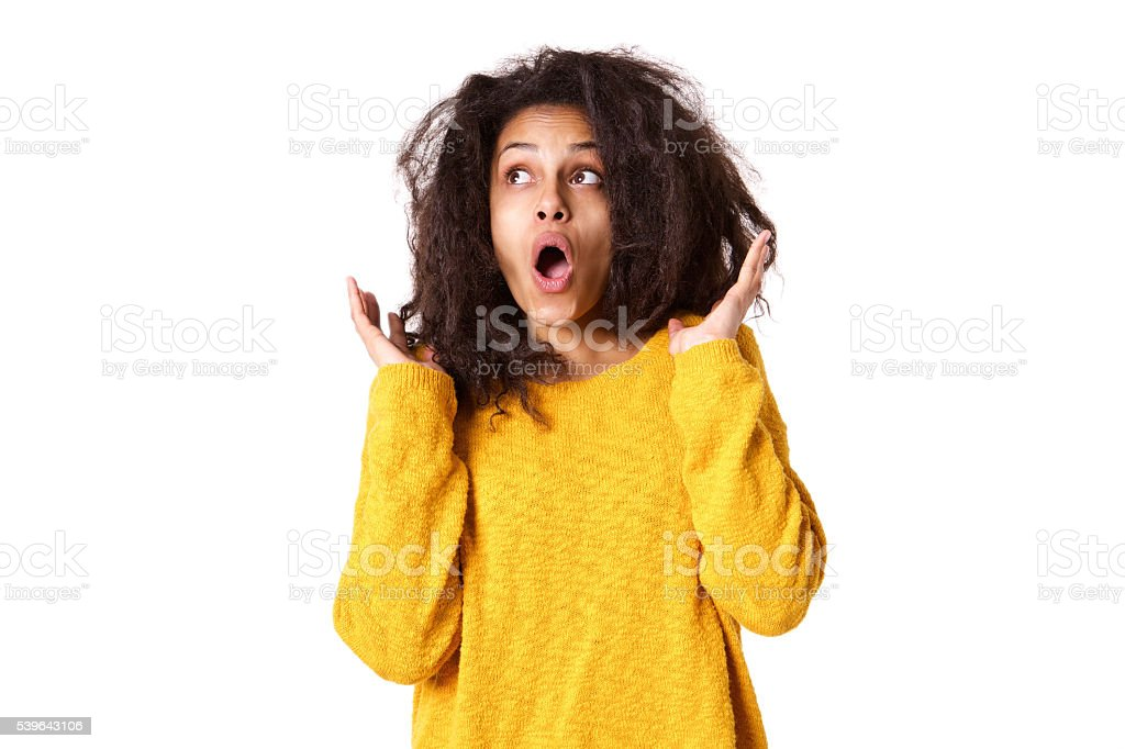 Young african woman looking surprised stock photo