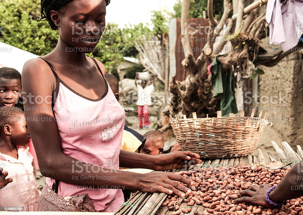Young african woman selling nuts - Ghana, Africa stock photo