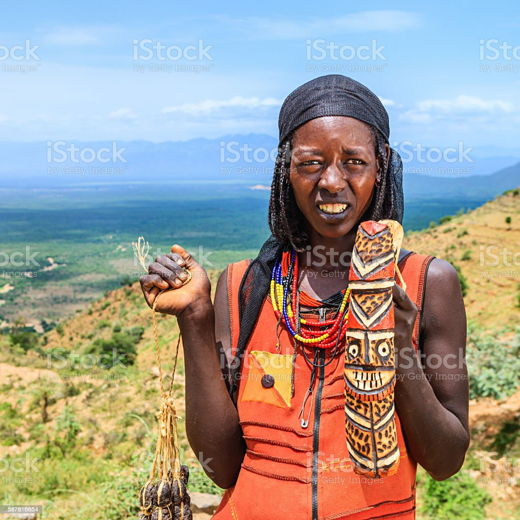 Young African woman selling souvenirs in Omo Valley, East Africa stock photo