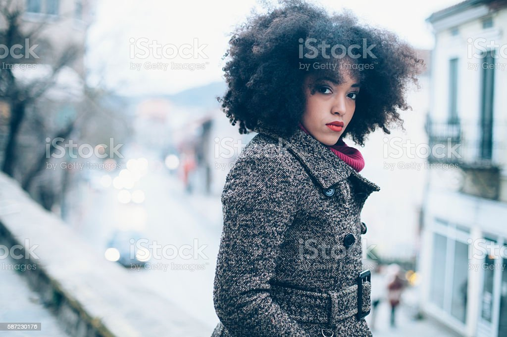 Young african woman standing in front of an ancient building stock photo