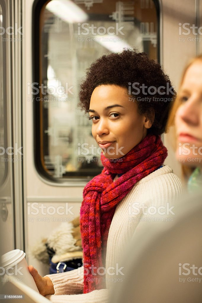 Young african woman traveling by subway train stock photo