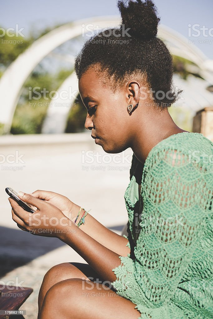 Young african woman using mobile phone royalty-free stock photo