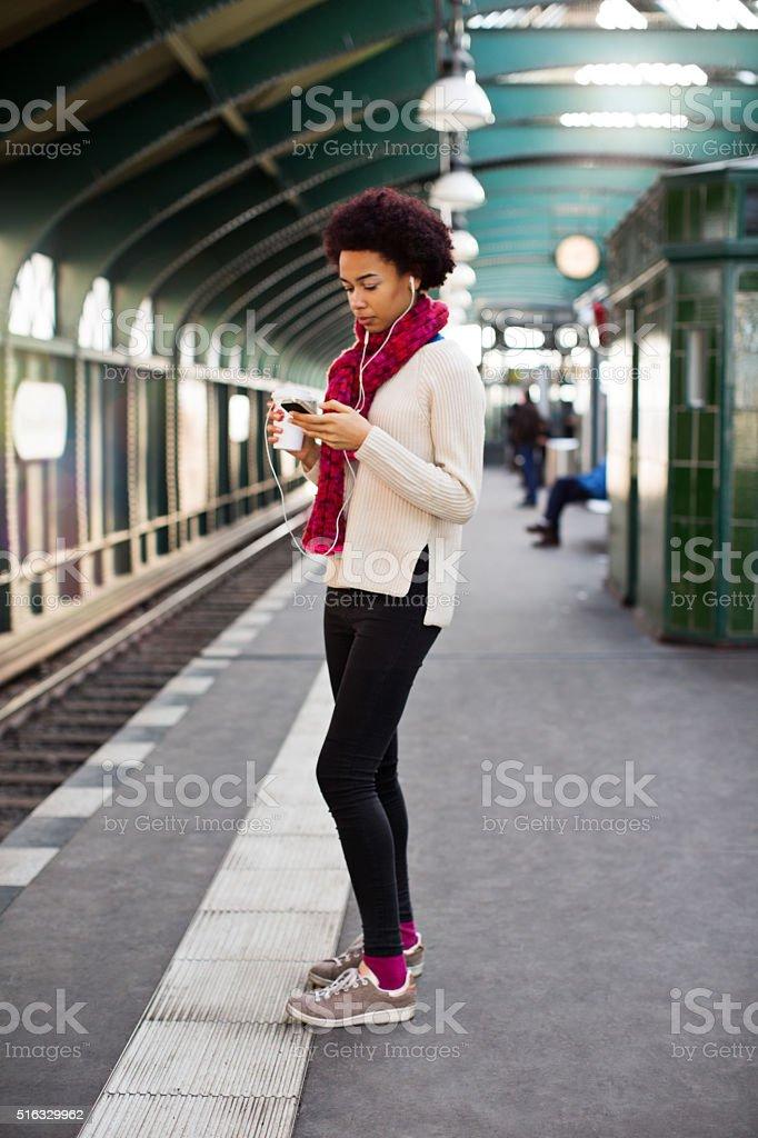 Young african woman waiting at subway station stock photo