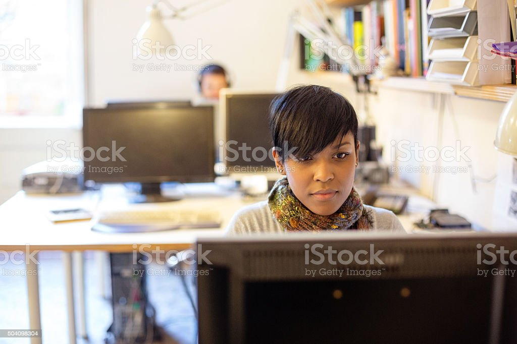 Young african woman working at a startup stock photo