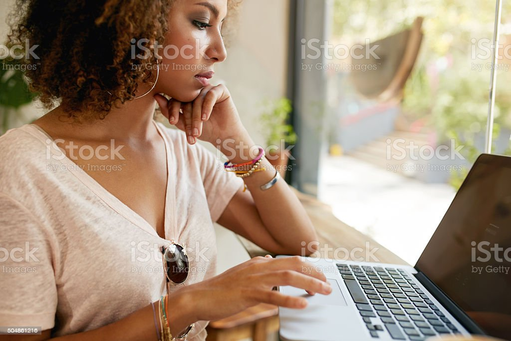 Young african woman working in coffee shop stock photo