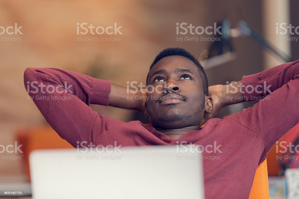 Young African-American business man taking a break at his desk stock photo