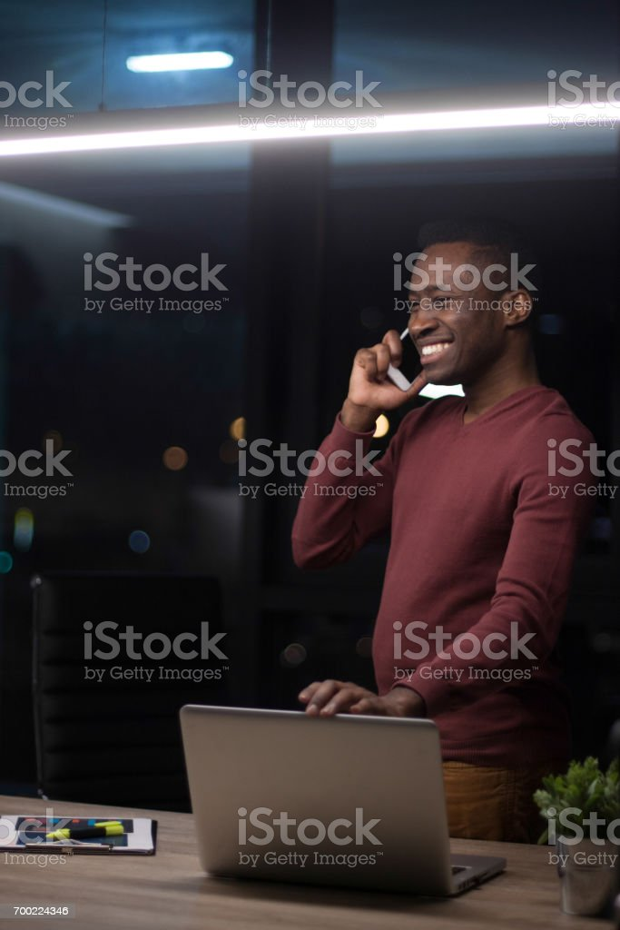 Young african-american businessman is working on his laptop in office stock photo