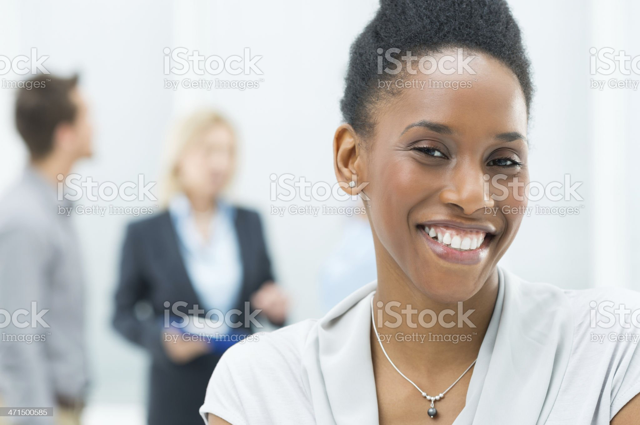 Young African-American businesswoman smiling royalty-free stock photo