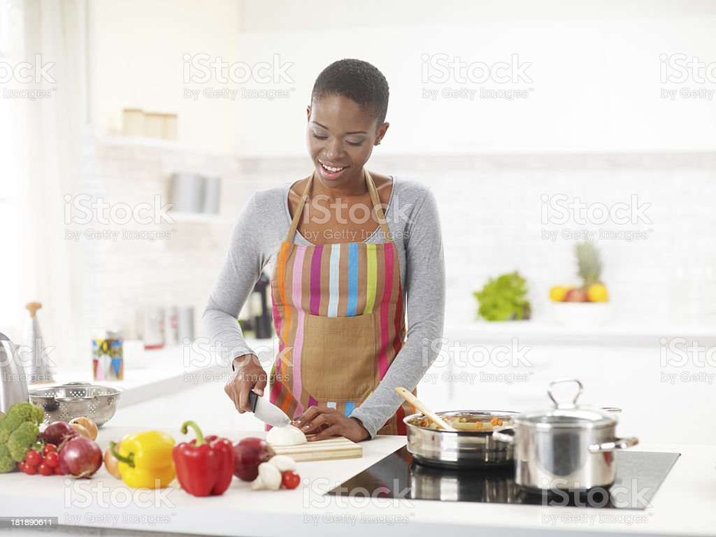 Young African-American Woman Preparing Delicious Lunch royalty-free stock photo