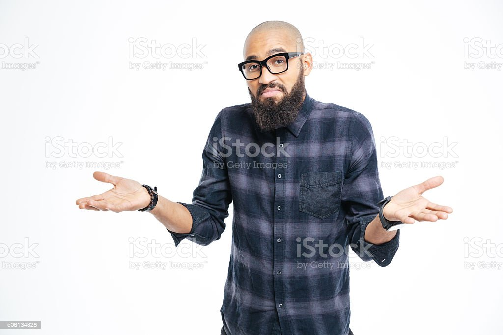 Young afro american man shrugging shoulders stock photo