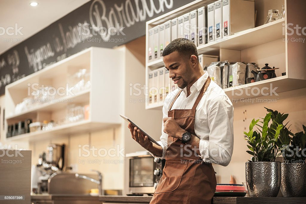 Young afro-american bar owner ordering stock stock photo