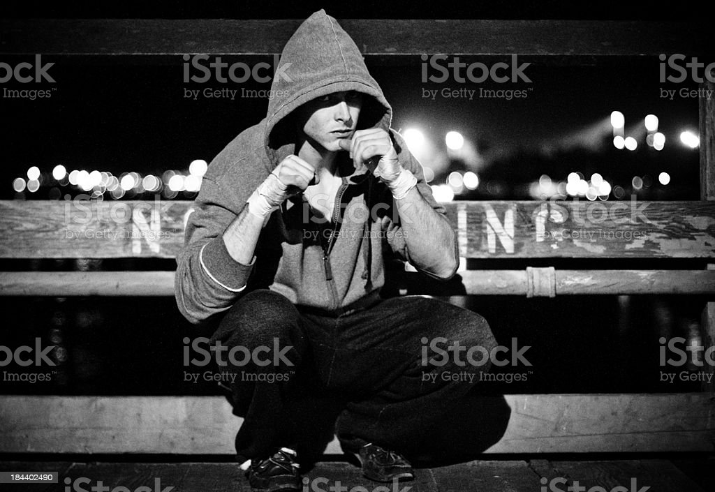 Young american boxer training at night stock photo