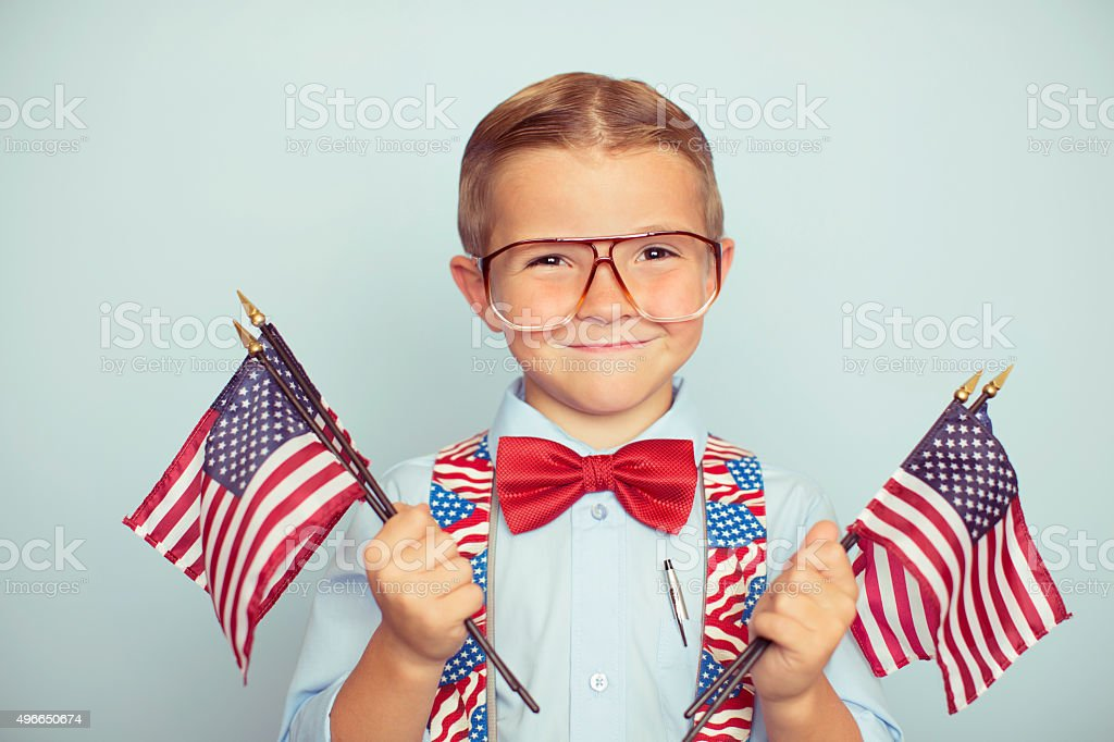 Young American Boy Holding Flags on Election Day stock photo