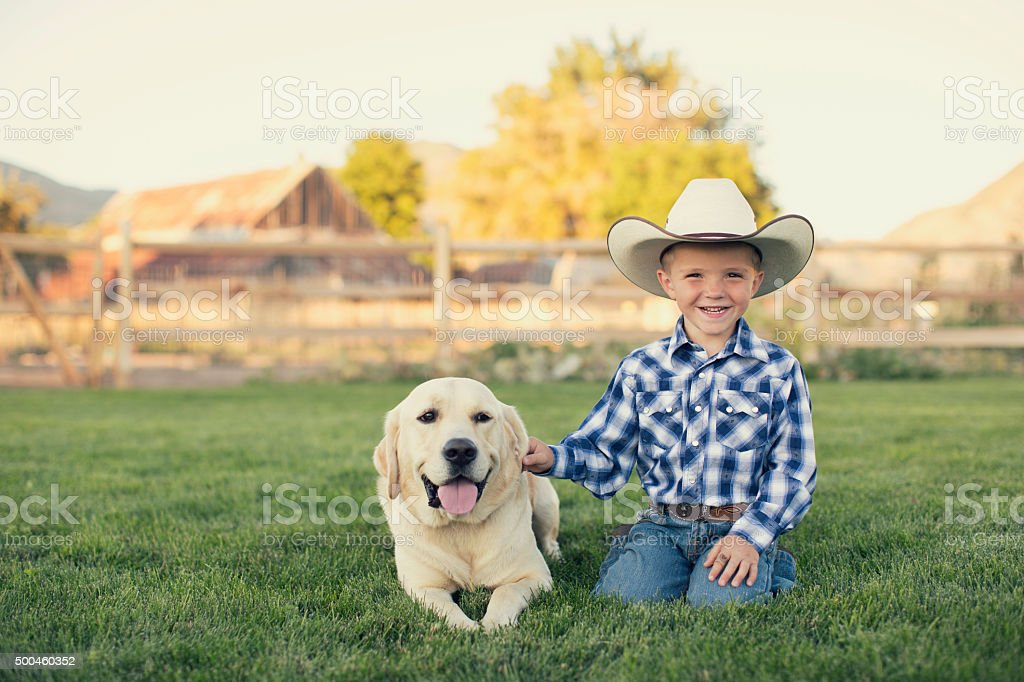 Young American Cowboy and His Dog stock photo