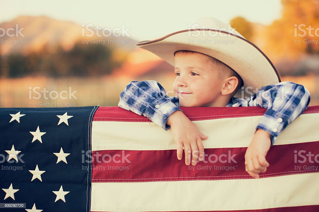 Young American Cowboy with US Flag stock photo