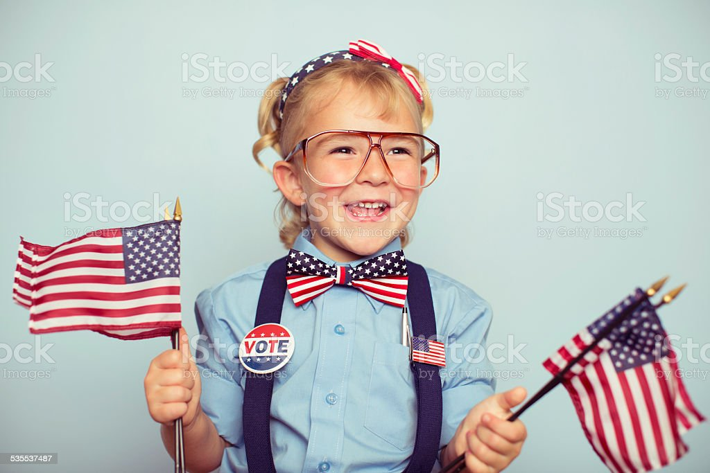Young American Girl with American Flags stock photo