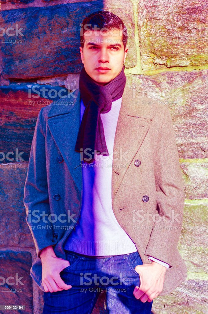 Young American Man standing between dark and bright stock photo