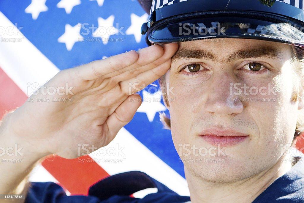 young american policeman saluting royalty-free stock photo