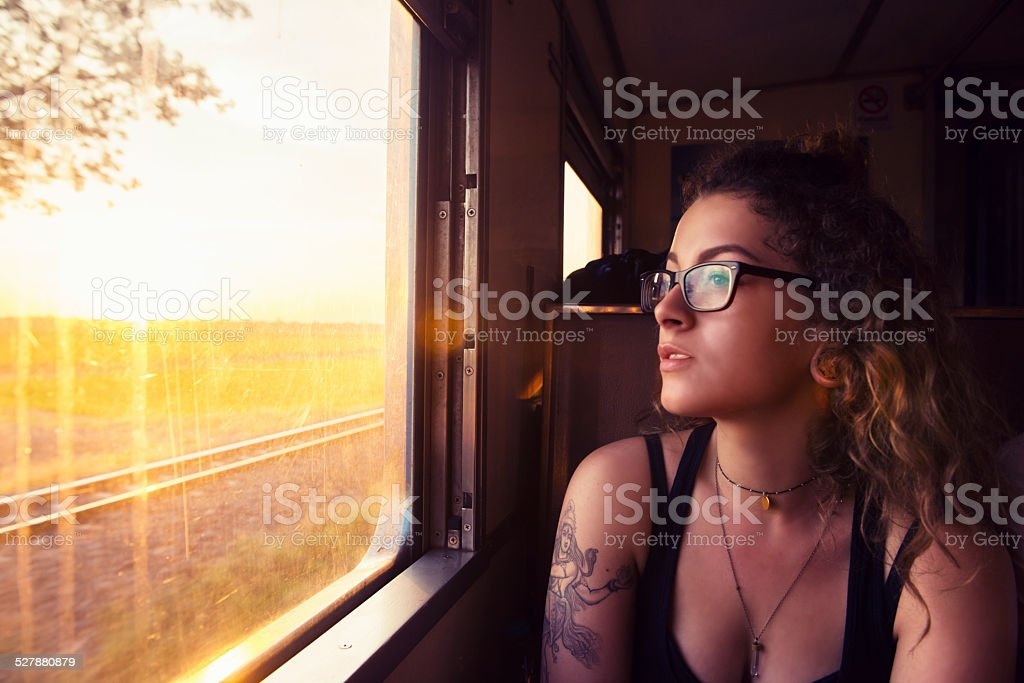 Young American Travels Thailand by Train at Sunrise stock photo