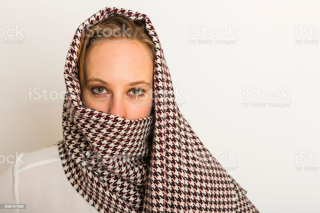 young american woman covering head in studio at istanbul turkey stock photo