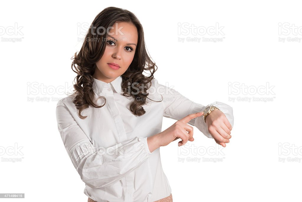 Young and Attractive Female Showing on Her Clock royalty-free stock photo