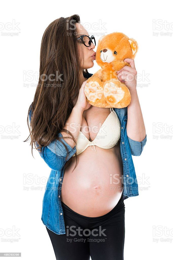 Young and Beautiful Pregnant Woman how Kissing Teddy Bear stock photo