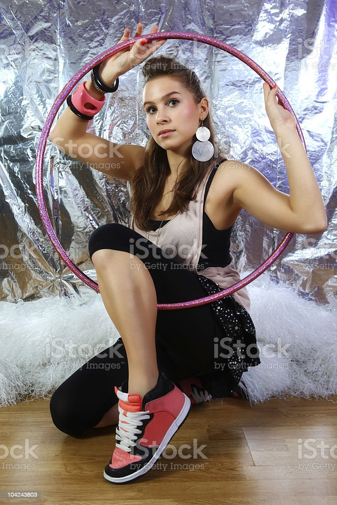 Young and beautiful woman holding pink glitter hoop stock photo
