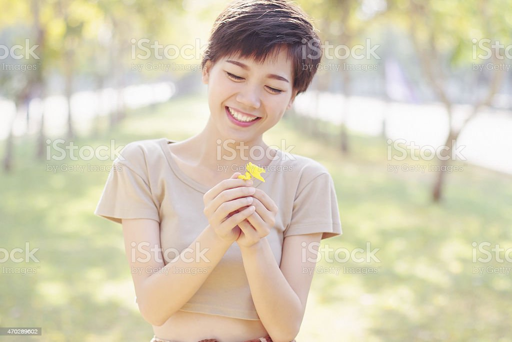young and beautiful woman laughing face pastel color style stock photo