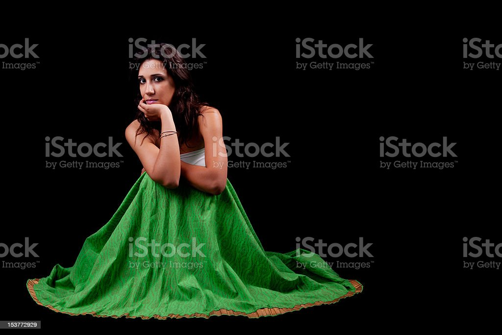 young and beautiful woman  seated pensive royalty-free stock photo