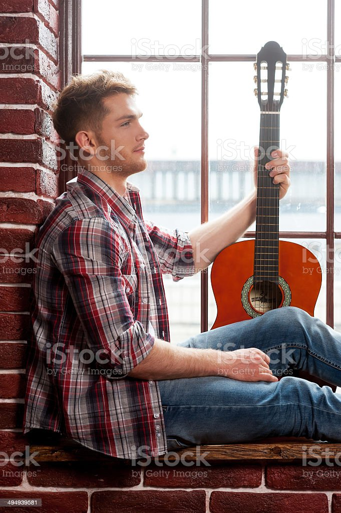 Young and creative guitarist. royalty-free stock photo