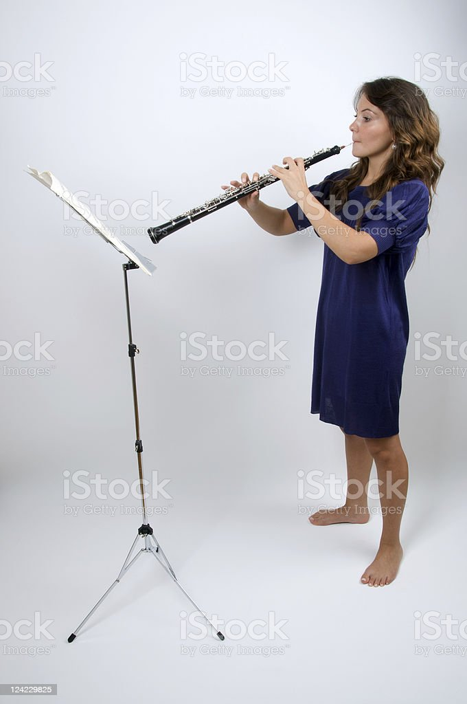 Young and determined oboist stock photo
