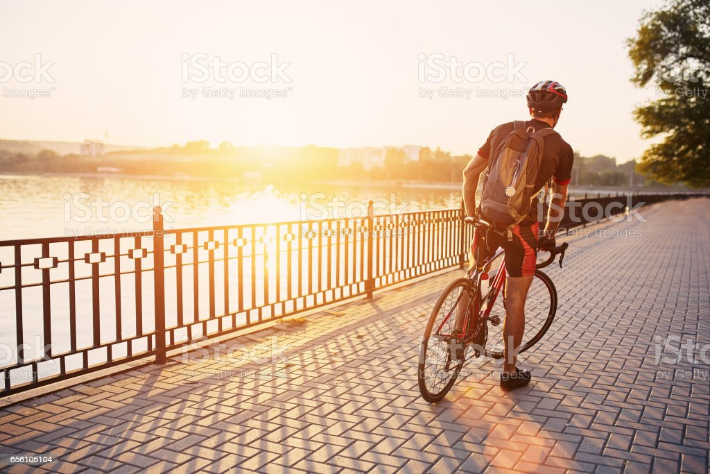Young and energetic cyclist in the park stock photo