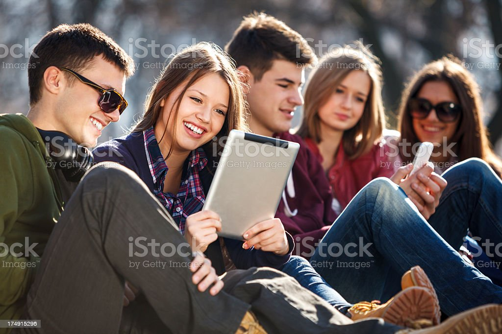 Young and happy urban people having fun with digital tablet royalty-free stock photo